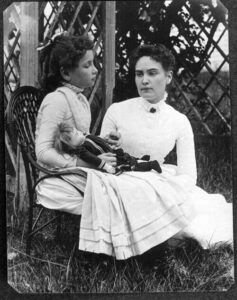 Helen Keller age 8 with tutor Anne Sullivan in July 1888